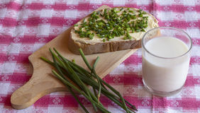 Bread with butter and chives Royalty Free Stock Photos