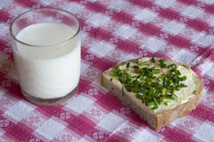 Bread with butter and chives Stock Image