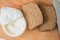 Bread and butter on chopping board Stock Photos