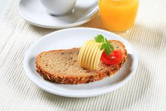 Bread with butter, cup of tea and orange juice Stock Images