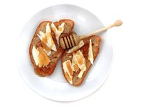 Bread, butter and fresh honey Royalty Free Stock Photos