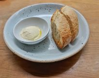 Bread and butter homemade in ceramic plate. On a wooden table. Good as an appetizer Royalty Free Stock Photography
