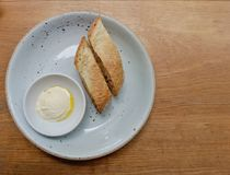 Bread and butter homemade in ceramic plate on a wooden table. Top view of food Royalty Free Stock Photo