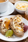 Bread with butter, honey and nuts for breakfast, close-up Stock Photos