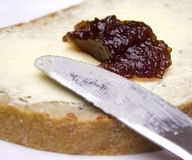Bread with butter and jam Stock Images