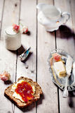 Bread with butter, jam and yogurt Stock Image