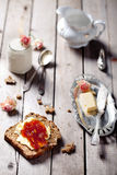 Bread with butter, jam and yogurt Royalty Free Stock Photography