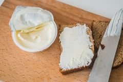 Bread and butter with knife Royalty Free Stock Photos