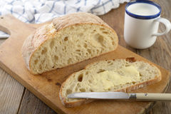 Bread with butter and milk Stock Photo