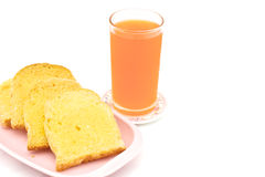 Bread butter with orange juice. Bread baked with butter and sugar placed in a pink tray with orange juice on white background Stock Images