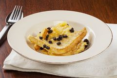 Bread and Butter Pudding. A serving of homely bread and butter pudding Stock Image