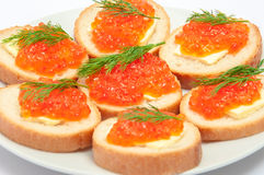 Bread with butter and red caviar in white plate. Sandwiches with. Red caviar stock photo