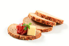 Bread with butter and salami Stock Photo
