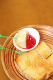 Bread, butter and strawberry jam Stock Photography