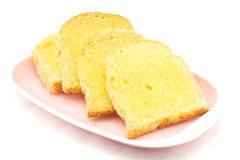 Bread with butter and sugar. Bread baked with butter and sugar placed in a pink tray on white background Royalty Free Stock Photos