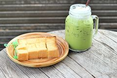 Bread, butter, topped milk and green tea. Stock Image