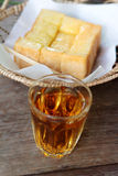 Bread, butter, topped milk with tasty and tea Stock Images