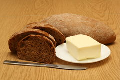 Bread and butter. On the wooden table royalty free stock photos