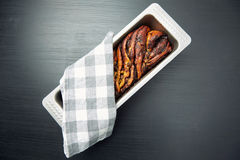 Bread Cake on a Tin Tray with Cloth on Top Stock Photo