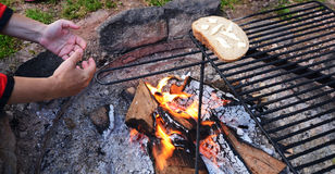 Bread on camping fire Stock Photo
