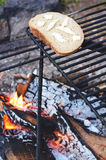 Bread on camping fire Royalty Free Stock Image