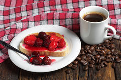 Bread with canned fruits and coffee Stock Photo