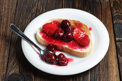 Bread with canned fruits Stock Photography