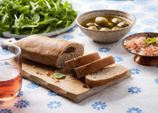Bread with Carob powder, olives, pink salt and rucola Stock Photography