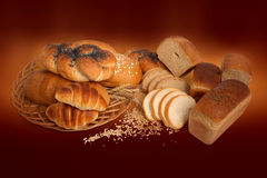 Bread and cereals. Good bread, cereals and croissants on the brown background Stock Photography