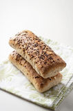 Bread with cereals and flax seeds on a clean linen. Bread with cereals and flax seeds on a linen Stock Photos