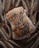 Bread with cereals and flax seeds on ears of wheat. Bread with cereals and flax seeds Stock Image