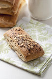 Bread with cereals and flax seeds on a linen. Bread with cereals and flax seeds Stock Image