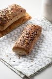 Bread with cereals and flax seeds. On a linen Stock Images