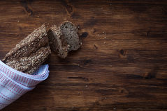 Bread with cereals and grain. Sliced bread with cereals on a wooden rustic table. Place for text Royalty Free Stock Images