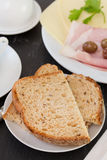 Bread with cereals. And ham Stock Images
