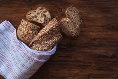 Bread with cereals. On a wooden rustic table Royalty Free Stock Photo