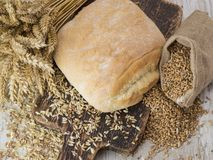 Bread with cereals on a wooden table. Italian bread with cereals and grain on a wooden gray table Stock Photo