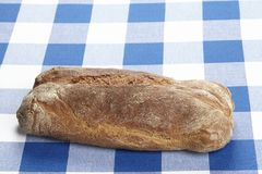 Bread on a checkered tablecloth Stock Photography