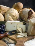 Bread and Cheese. An assortment of breads and cheeses on a table royalty free stock photos