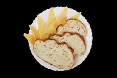 Bread and cheese. On the white plate Royalty Free Stock Images