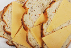 Bread and cheese. Close-up grain bread and cheese Stock Photography
