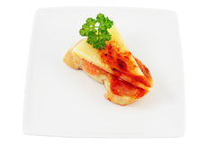 Bread with cheese. Dish of sheep's cheese with tomato and paprika with olive oil and parsley cut isolated Royalty Free Stock Images