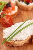 Bread and cheese. Bread with cheese on board Royalty Free Stock Photos