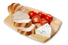 Bread and cheese. With tomatoes on a chopping board stock image