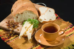 Bread And Cheese. Bread, chesse and cup of tea royalty free stock images
