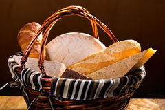 Bread and cheese in a basket Royalty Free Stock Images