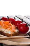 Bread with cheese and carrot on wooden board Stock Photo