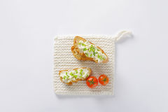 Bread with cheese and cherry tomatoes Stock Photography