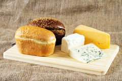 Bread and cheese on cloth background Royalty Free Stock Images