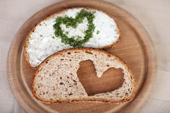 Bread With Cheese Cream Spread And Heart Made Of Herbs In Plate Stock Photos